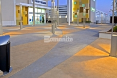 This decorative concrete paving features an interior checkerboard pattern that was inspired by the racetrack infield at nearby Daytona International Speedway and the use of Bomanite Integral Color with two-tone coloration will provide longevity and durability of color.