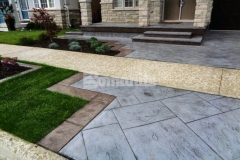 Bomanite Shale Gray Color Hardener and a Gray Release Agent were utilized here with the Bomacron Yorkshire Stone imprint pattern to create a decorative driveway and patio that complement the existing concrete walkway and provide the beauty of natural paving with the durability and affordability of concrete.