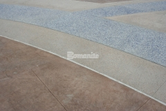 Bomanite Sandscape Texture and Bomanite Revealed are surrounded by bands of Bomanite Slate Texture stamped concrete, which was chosen to add a distinct architectural touch to the project while providing the durability to stand up to the toughest traffic loads and environmental conditions.