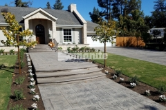 Bomanite Bomacron stamped concrete was installed here by our colleague Heritage Bomanite to create this stunning driveway and walkway and the English Sidewalk Slate imprint pattern is an eye-catching design element that perfectly accentuates the European flair of this Fresno, California home.