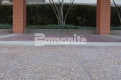 Musselman & Hall Contractors installed Bomanite Bomacron English Sidewalk Slate imprinted concrete with a Bomanite Sandscape Texture Exposed Aggregate finish to renovate the aging pavement at the front entrance to the Residence Condominiums, providing a durable hardscape surface with function and style.