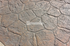 The hardscape surfaces at the Tanger Outlets Fort Worth feature an earthy, natural stone appearance with rich texture, elegant beauty, and sustainability and were created by installing Bomanite stamped concrete with the Bomacron Canyon Stone pattern.
