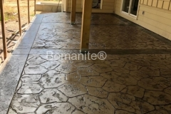 Stone Patio using Bomanite Imprint Systems with Bomacron Textured Pattern Imprinted Concrete by Clark's Concrete Construction.