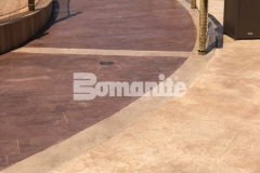 Bomanite imprinted concrete was used here to create a distinctive and decorative hardscape that includes this stunning Bomacron Boardwalk pattern that resembles wood planking and adds beautiful design detail to this outdoor space.