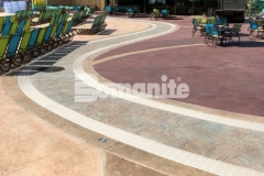 This beautiful and unique hardscape surface was created using Bomanite Imprint Systems and featured here are multiple Bomacron patterns including Garden Stone, Boardwalk, Sandstone Texture, and Slate Texture that all integrate perfectly to add distinctive design detail to this decorative concrete hardscape.