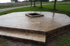 Firepit using Bomanite Imprint Systems with Bomacron Textured Pattern Imprinted Concrete by Clark's Concrete Construction.