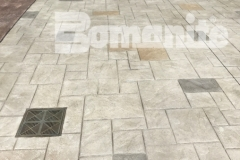 Bomanite imprinted concrete was installed here to create a decorative hardscape surface that features the Bomacron Ashlar Slate pattern bordered by an integrally colored gray band for a combination that adds a beautiful, distinctive design aesthetic to this outdoor space.