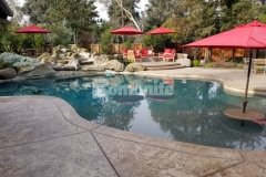 Bomanite Sand Color Hardener and Bomanite Light Brown Release Agent were combined here with the Bomacron Slate Texture pattern to create a stamped concrete pool deck and patio area, adding slip-resistance and durability while creating character with texture and color.