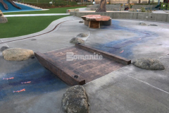 The 12-inch Bomanite Bomacron Boardwalk pattern was utilized here to create a distinct play feature with stamped concrete bridge planks and sides that make up the wooden bridge and enhance the innovative play space at Inspiration Playground at Downtown Bellevue Park.