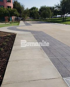 Long view of sidewalk and driveway at Valley Children's Hospital with Bomanite Decorative Exposed Aggregate Revealed and Sandscape Texture Systems installed by Heritage Bomanite located in Fresno, CA.