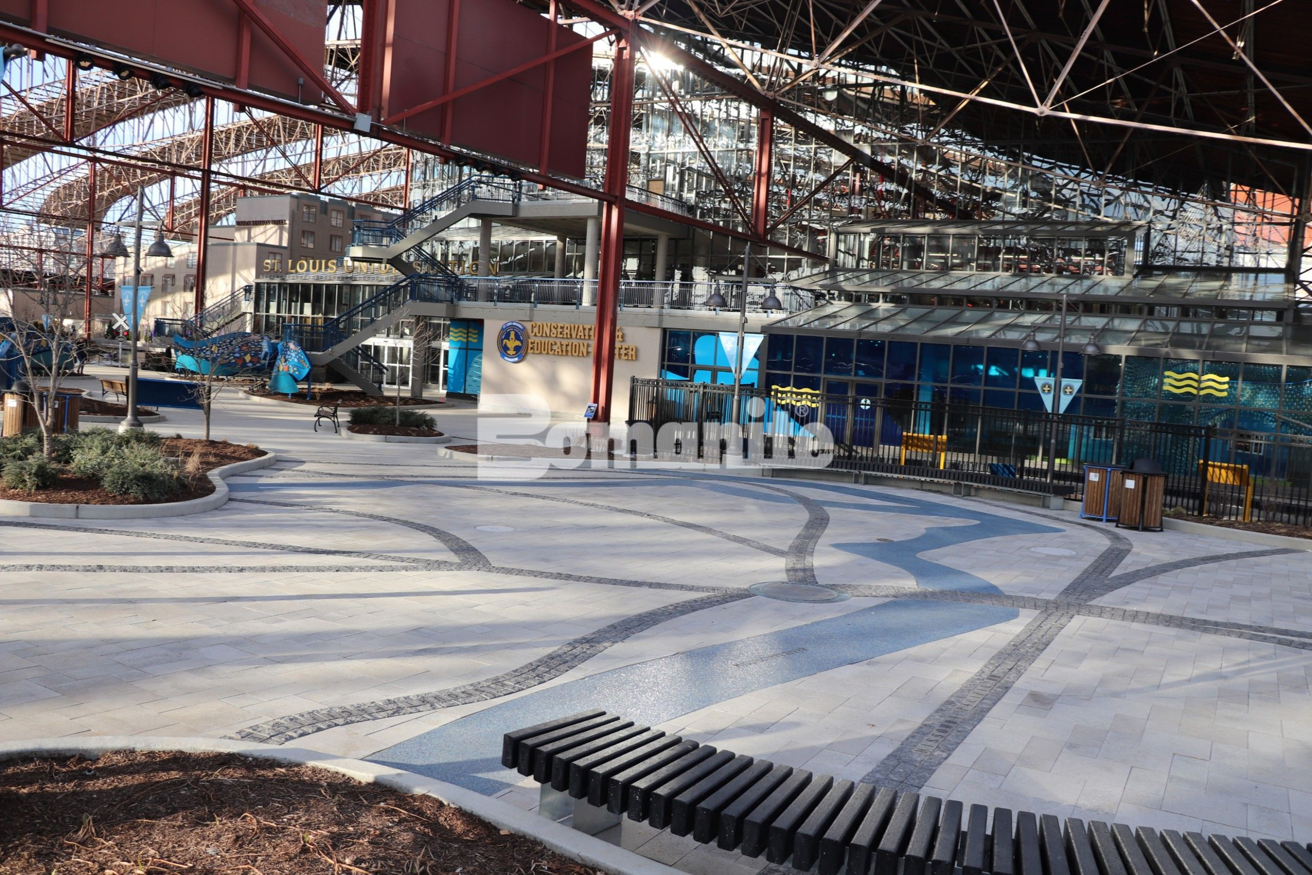 Themed Entry Way of St. Louis Aquarium at Union Station Creates River of Glass with Bomanite Revealed Exposed Aggregate for the River Confluence created by PGAV Destinations and installed by Musselman & Hall Contractors.